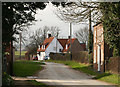 SE9646 : Cottages in Holme-on-the-Wolds by Peter Church