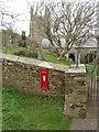 SX1497 : St Gennys church with Victorian post box by David Hawgood