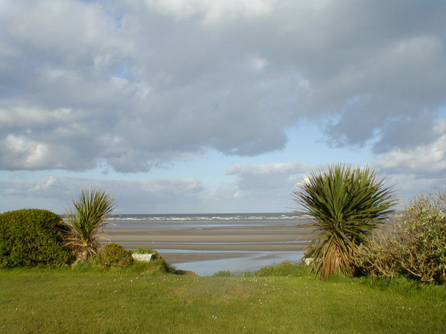 The beach from the garden of a B & B