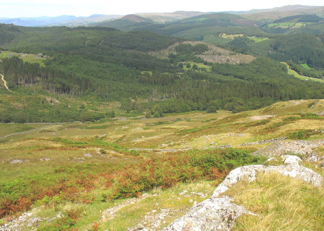Land sloping down to the forested Nant Las valley
