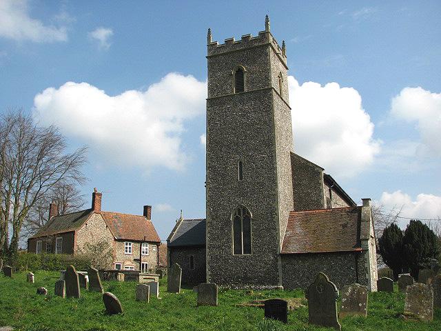 All Saints church and adjacent cottage