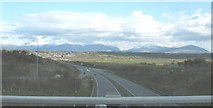 SH4473 : View south along the A55 Expressway with Snowdonia in the background by Eric Jones