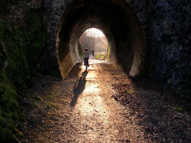 Cycling through old railway tunnel