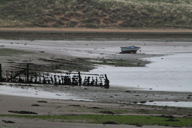 Fence and Small Boat in the Esk Estuary