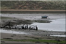 SD0894 : Fence and Small Boat in the Esk Estuary by Steve Partridge