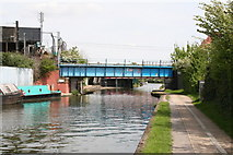 TQ2282 : Railway bridge 7D, Paddington Arm, Grand Union Canal by Dr Neil Clifton