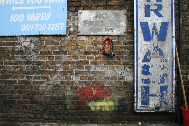 Wall with Lock, Signs and Paint