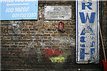 TQ2976 : Wall with Lock, Signs and Paint by David Lally