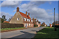 SE9646 : The cottages opposite the bus shelter, Holme on the Wolds by Peter Church