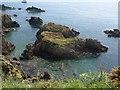 SX8848 : Rocks off Western Combe Cove by Derek Harper