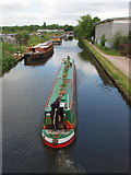 TQ0580 : Narrowboat from footbridge to Slough Arm by David Hawgood