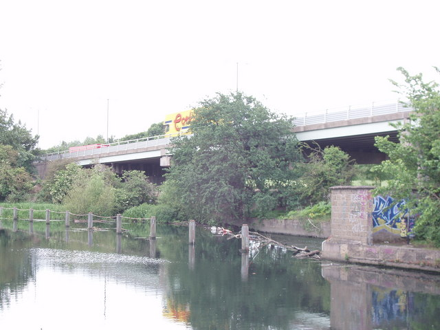 Weir from canal to River Brent, by the M4 by David Hawgood