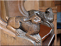 TG1743 : The church of All Saints - bench ends by Evelyn Simak