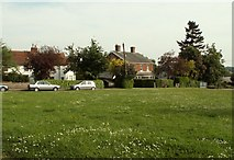 TL8530 : The village green at Colne Engaine by Robert Edwards