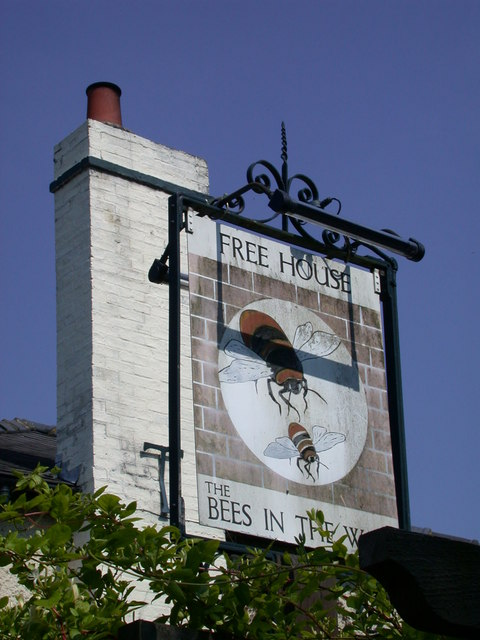 The Bees in the Wall - sign