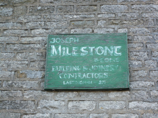 Fading but historic trade sign on cottage in Appleton-le-Moors