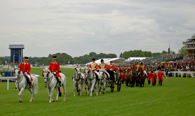 The Royal carriages leave after carrying The Queen to the races