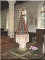 TF9521 : St Bartholomew's church - C15 baptismal font by Evelyn Simak