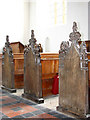 TG2227 : The church of SS Peter & Paul - bench ends by Evelyn Simak