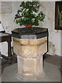 TF8442 : St Clement's church - baptismal font by Evelyn Simak
