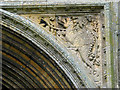 TG1323 : St Agnes' church - west doorway detail by Evelyn Simak
