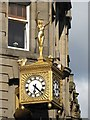 NZ2464 : Golden naked woman; and clock by Mike Quinn