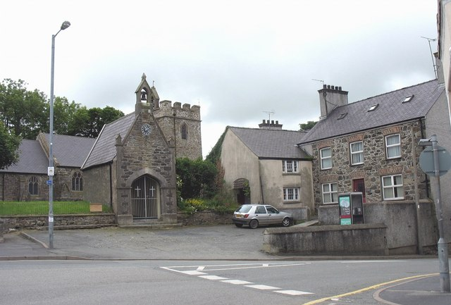The Church of St Mary, the lych gate and the old rectory viewed across the town square