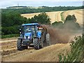 SU9609 : Muck-spreading on Little Down, Slindon by Andrew Smith