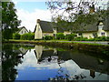 TL2379 : Cottages and duckpond by Jonathan Billinger