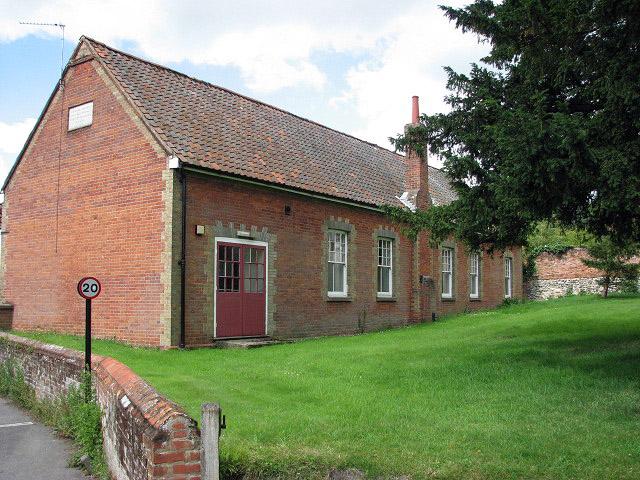 School building adjoining the churchyard