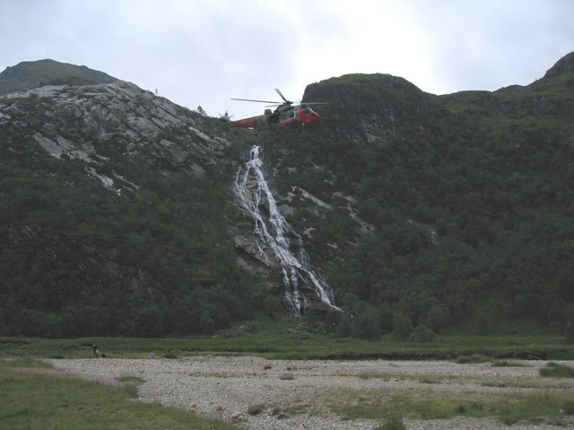 Royal Navy helicopter over Steall waterfall
