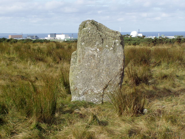 Upper Dounreay Standing Stone with reactor behind.
