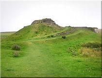 NU1341 : Outcrop near Lindisfarne Castle by Chris Gunns