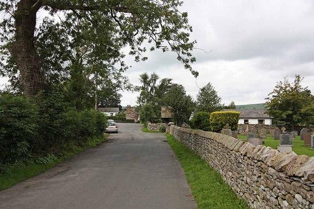Road past St Bartholomew's church, Barbon, Cumbria