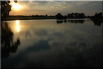 SO8843 : A sinking sun over Croome River by Philip Halling