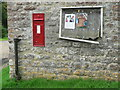 ST5502 : Uphall: postbox № DT2 65 and noticeboard by Chris Downer
