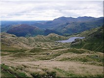 NY2807 : Glimpse of Stickle Tarn from Blea Rigg by Peter S