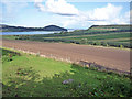 NH6651 : Fields below Culnacraigh Farm by Julian Paren
