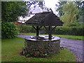 ST3794 : Village well in Treddunock by andy dolman