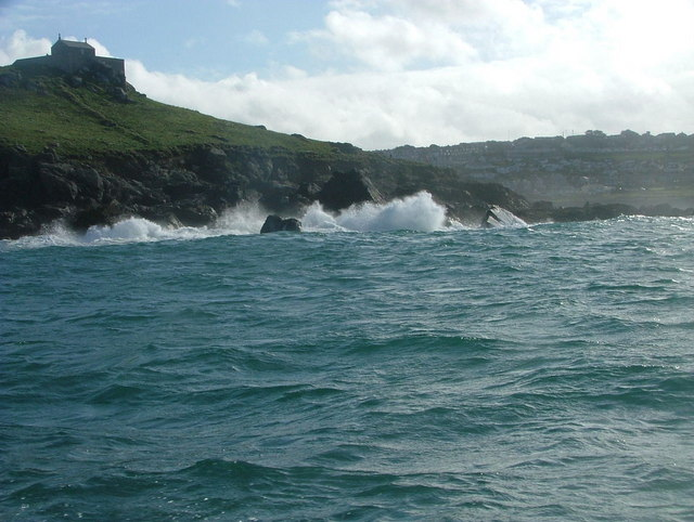 Waves break against St Ives Head