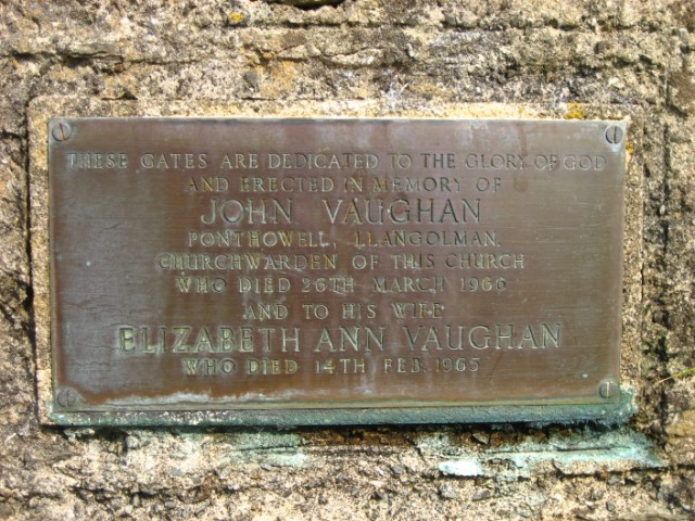 Plaque on the gatepost at St Colman's Church
