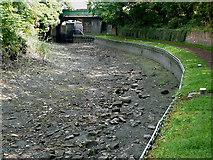 SO8685 : Stourbridge Canal empty below Four Locks Bridge, Stourton by Roger  Kidd