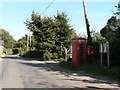 SY8897 : Anderson: postbox № DT11 122, phone and noticeboard by Chris Downer