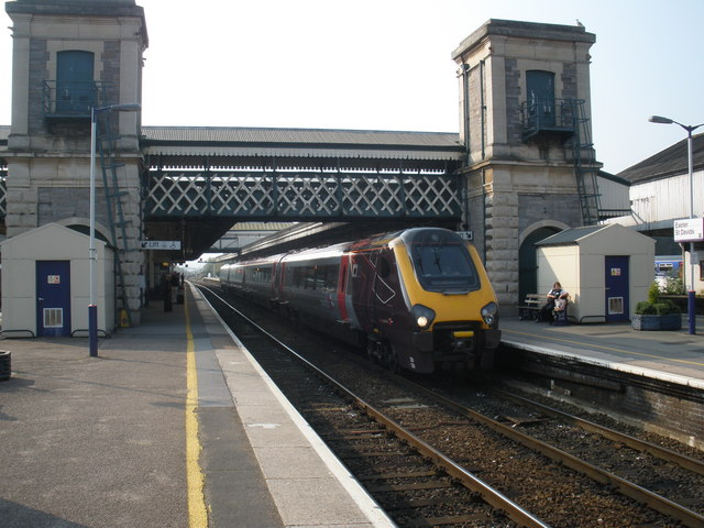 A train departs to the north, from Exeter St David's