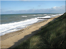 TG3930 : The beach below Eccles on Sea by Evelyn Simak