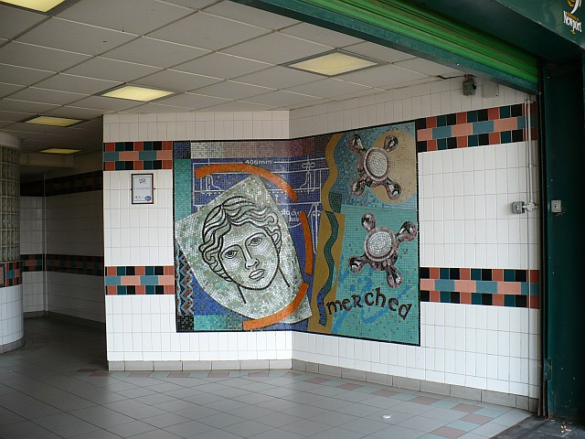 Mosaic at the entrance to the ladies toilets by Robin Drayton