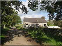 SK1855 : Lane view of farm building beyond Foufinside Farm by Alan Heardman